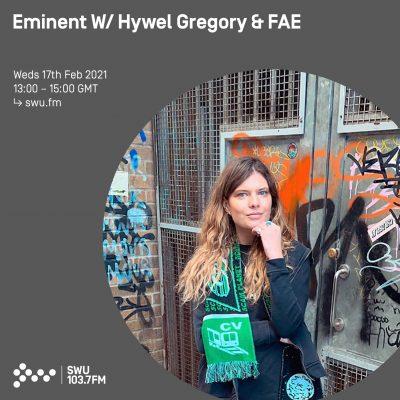 DJ Fae stood infront of grafitti